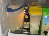 Cold household fridge stored saturated water based brine and water based brine ripening feta in plastic containers.
